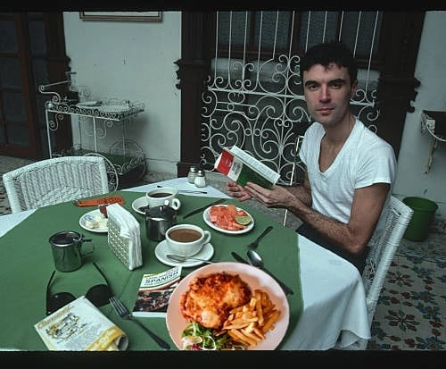 Rare photo of Talking Heads' David Byrne about to dig into a classic pub parma. Which just so happen to be $15 on Monday nights here, every week.  That's same as it ever was. Same as it ever was. Same as it ever was..